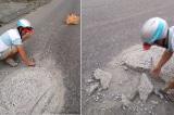 2 người thợ đục khối bêtông nằm giữa đường để mọi người không bị tai nạn